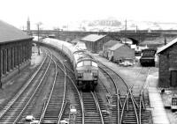 Approaching the Dumfries stop in October 1972 is the morning Leeds - Glasgow Central train, with the usual ^Peak^ type 4 locomotive in charge.