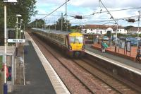 On 27th July 2010 the 10.30 Glasgow Central - Ayr train runs into Barassie station for its 11.10 scheduled stop. [See image 21465 for the same viewpoint forty seven years earlier]<br><br>[Colin Miller&nbsp;27/07/2010]