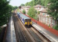 A Preston to Manchester and Hazel Grove service runs in to Lostock station past some of the new housing developments that made it viable to reopen the station after a long period of closure. 150275 is the unit in use in this view towards Chorley and Preston. <br><br>[Mark Bartlett&nbsp;26/06/2010]