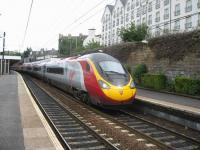 On certain summer Saturdays, in order to provide additional seating capacity, some Edinburgh - Birmingham services are worked by Pendolinos rather than Voyagers. One such example is the 14.52 departure from Edinburgh, seen here calling at Haymarket on 31 July 2010.<br><br>[Michael Gibb&nbsp;31/07/2010]