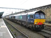DRS 66417 and friend pause at Carlisle on 31 July with a nuclear flask train.<br><br>[Michael Gibb&nbsp;31/07/2010]