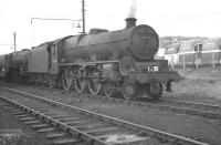 Much of the visiting Blackpool excursion traffic during the summer months used the stabling sidings and turntable at Bloomfield Road, which was preferred by crews, being quicker than going through the main shed procedures at Blackpool Central and thus allowing more time for <I>relaxation</I> between turns. The photograph shows Jubilee no 45710 <I>Irresistible</I> of Manchester's Newton Heath shed carrying an excursion headcode standing in Bloomfield Road sidings in 1962. The floodlights of Blackpool FC's Bloomfield Road ground can be seen in the background. [See image 30224 for the scene fifty years later].<br><br>[K A Gray 23/09/1962]