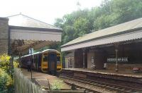 Hebden Bridge, as seen from the station forecourt looking east. 158849 is on a Calder valley line Manchester to Leeds service. <br><br>[Mark Bartlett&nbsp;20/07/2010]