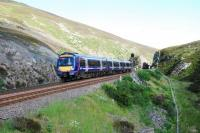 A southbound service heads for the narrows at Slochd Summit loop.<br><br>[Ewan Crawford&nbsp;22/07/2010]