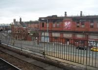 The derelict but substantially intact Manchester Mayfield station, as seen from the Deansgate line island platform at Piccadilly. This picture shows the main station building, the approach ramp and the trainshed behind. Mayfield was seen as an extension of the then London Road (later Piccadilly) station but closed to passengers in 1960, following which it was for a long time used for parcels trains. Over the years there have been numerous proposals for this prime city centre site, including reopening to rail traffic, but nothing has yet transpired. [See image 30526]<br><br>[Mark Bartlett&nbsp;09/07/2010]