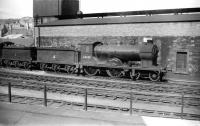 Reid D30 <I>Scott</I> class 4-4-0 no 62425 <I>Ellangowan</I> standing alongside Hawick shed in May of 1958. Built in 1914, the locomotive was withdrawn some 3 months after the photograph was taken and disposed of through Motherwell Machinery & Scrap, Wishaw, in February 1960.<br><br>[Robin Barbour Collection (Courtesy Bruce McCartney)&nbsp;03/05/1958]