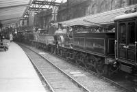 An exhibition of vintage locomotives and rolling stock at Carlisle platform 6 in June 1958. The locomotive nearest the camera is the preserved Samuel Johnson Midland Railway <I>Spinner</I> no 118 (later no 673). This locomotive is now a static exhibit at the NRM in York.<br><br>[Robin Barbour Collection (Courtesy Bruce McCartney)&nbsp;07/06/1958]