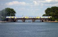 View across the Binnenalster, with one of the local <I>Metronom</I> services approaching Hamburg's main station on the afternoon of 27 July 2010.<br><br>[John Steven&nbsp;27/07/2010]
