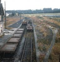 Demolition and recovery work in progress at Kelso station in 1970. View is north east from the now demolished road bridge towards Coldstream along what would eventually become the route of the A698 by-pass. [See image 27928]<br><br>[Bruce McCartney&nbsp;//1970]