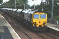 Freightliner 66506 runs south through Barassie station with coal empties on 27 July 2010.<br> <br><br>[Colin Miller&nbsp;27/07/2010]