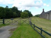 The site of the goods yard at Knock station, given away by the distinctive railway gates. The goods loading bank is just behind with the remains of the passenger platform adjacent to the left.<br> The location is now owned and well maintained by the Knockdhu distillery.<br><br>[John Williamson&nbsp;05/08/2010]