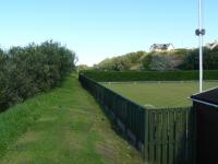 The site of Portgordon station, looking east towards Buckpool and Buckie, in August 2010. Half of the site is now occupied by the local bowling club. The line ran along the edge of the bowling green with the station building situated approximately at the far end of the green.<br><br>[John Williamson&nbsp;05/08/2010]