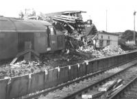 Mishap at Grantshouse. On 8 August 1961 EE Type 4 no D249 failed to stop after being routed into the up loop at Grantshouse, with the inevitable result shown here. The locomotive carried the scars for many years, including a different coloured front end. This may also have been the last occasion on which ECML trains were diverted via Kelso to Tweedmouth.  Taken on 9 August, the day after the mishap.<br> <br><br>[Jim Peebles&nbsp;09/08/1961]