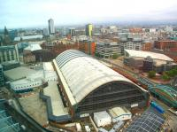 View over Manchester Central from the Beetham Tower on 28 September 2009. Closed to rail traffic in 1969 the old CLC station was subsequently refurbished and relaunched as the G-Mex Conference and Exhibition Centre in 1986 before regaining its original identity in 2008. The Midland Hotel stands opposite the far end of the building and a Metrolink tram can be seen running past on the right. <br><br>[Ian Dinmore&nbsp;28/09/2009]
