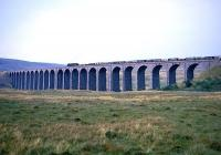 A steam-hauled freight heads north over Ribblehead Viaduct in the 1960s.<br><br>[Robin Barbour Collection (Courtesy Bruce McCartney)&nbsp;//]