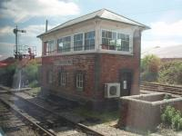 Goonbarrow Junction signal box, as seen from the window of a Newquay to Par service on 15 June 2010. The train has just called to surrender the staff for the long single line section from Newquay and pick up the token for the next section to St. Blazey. [See image 26480] for a panoramic view of the China Clay works just visible in the background of this picture.<br><br>[Mark Bartlett&nbsp;15/06/2010]