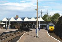 View east at Dundee station in August 2010. On the left a Glasgow Queen Street - Aberdeen service is preparing to restart its journey from platform 4, while on the right an Aberdeen - Kings Cross HST has just arrived at platform 1.<br><br>[Brian Forbes&nbsp;05/08/2010]