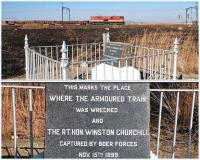 Class E18 locomotive no 18 320 in Transnet livery hauls two wagons of rails past the site�where Winston Churchill was captured by Boer forces in 1899. The spot is approximately half way between Estcourt and Colenso in South Africa's KwaZulu-Natal province. A close-up of the commemorative marker is shown below.<br><br>[John Gray&nbsp;02/08/2010]