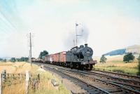 Fowler 4F 0-6-0 no 43922 takes a freight south on the approach to Symingon station on 29 August 1959, no doubt on its way home to Carlisle.<br><br>[A Snapper (Courtesy Bruce McCartney)&nbsp;29/08/1959]