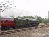 <I>All apparently forgiven</I>. On the anniversary of the end of BR steam <I>Fifteen Guinea Special</I> Royal Scot no 46115 <I>Scots Guardsman</I> is entrusted with the third <I>Fellsman</I> special train and leaves Lancaster hauling 12 coaches up the 1:92 gradient, without diesel insurance. The previous tours had featured 45690 and 48151 so there is certainly variety for the 2010 programme and its good to see the Scot working well again after recent mishaps. <br><br>[Mark Bartlett&nbsp;11/08/2010]