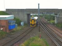 View south at Barassie on 27 July 2010 as the 11.07 Kilmarnock to Girvan negotiates the junction. Signal box to the left<br> <br><br>[Colin Miller&nbsp;27/07/2010]