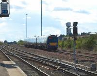A Glasgow Queen Street - Aberdeen service runs downhill out of the sun towards Dundee station on 5 August, past the site of the old Dundee West signal box [see image 5942].<br> <br><br>[Brian Forbes&nbsp;05/08/2010]