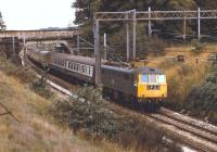 86222 speeds north on the WCML between Rugeley and Stafford in September 1974 and will shortly enter�the 776 yard Shugborough Tunnel. The train is thought to be a mid afternoon Euston to�Liverpool Lime Street service.<br> <br><br>[Bill Jamieson&nbsp;14/09/1974]