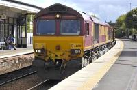 66108 passing through Inverkeithing on 10 August with pipe train for Georgemas Junction.<br> <br><br>[Bill Roberton&nbsp;10/08/2010]