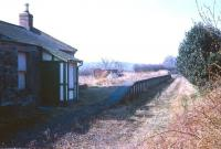 The former station at Nisbet, looking south towards Jedburgh in April 1969. Like the other stations on the Jedburgh branch it had lost its passenger service as long ago as 1948, although the line remained open for freight until 1964 (although some sources quote 1966). The old building is now an attractive converted cottage [see image 20109] <br><br>[Bruce McCartney&nbsp;/04/1969]