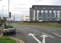 The large expanse of railway sidings that serviced Blackpool Central station until 1964 had long been known as Europe's largest car park, but in recent years has been improved and landscaped. This picture looks towards Central at the point where Bloomfield Road sidings were situated. The traffic lights mark the site of the former Bloomfield Road bridge that spanned the tracks and was only removed a few years ago. The white building is the home of Blackpool Football Club, back in the top flight in 2010/11 for the first time since 1971. [See image 30063] for a direct Then and Now comparison at the same location half a century earlier.<br><br>[Mark Bartlett 11/08/2010]