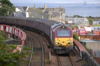 67030 with ECS off the 17.21 Edinburgh - Cardenden passing Burntisland Docks on 13 August.<br><br>[Bill Roberton&nbsp;13/08/2010]