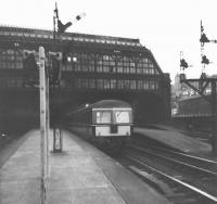 A DMU leaves Princes Street in 1965, the station's final year of operation.<br><br>[Jim Peebles&nbsp;//1965]