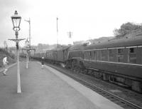 A4 Pacific no 60011 <I>Empire of India</I> hauling a train destined for Glasgow Queen Street arrives at Polmont in May 1960 propelling a failed Swindon InterCity DMU. The bay used by Bo'ness branch services is on the left. <br><br>[Robin Barbour Collection (Courtesy Bruce McCartney)&nbsp;07/05/1960]