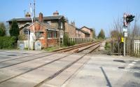 View north over the level crossing at Burton Agnes (closed 1970) on the Yorkshire coast line in April 2009, looking towards Bridlington. A station that appears to have had its ups and downs...<br><br>[John Furnevel&nbsp;21/04/2009]