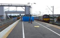 Platform 3 at Airdrie takes shape on 14 August 2010. A recent arrival stands at platform 2 while a westbound service is in the process of departing from bay platform 1.<br><br>[David Panton&nbsp;14/08/2010]