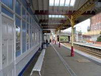 On 14 August the main station building at Coatbridge Sunnyside is caught in the middle of repainting with fresh FSR colours on the woodwork while the ironwork is still in SPT maroon and cream.� The effect is almost that of a doctored image. (It isn't!)<br> <br><br>[David Panton 14/08/2010]