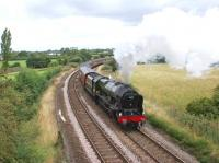 <I>The Fellsman</I> is currently a weekly service from Lancaster to <br> Carlisle via Preston, Blackburn and the Settle & Carlisle line. On 11 August 2010 ex-LMS Royal Scot class 4-6-0 no 46115 <I>Scots Guardsman</I> climbs away from the WCML at Farington Curve Junction on the approach to Lostock Hall. After a troubled year <I>Scots Guardsman</I> has gone some way towards making amends for its earlier failures. As well as turning in a faultless performance on this train, the locomotive came to the rescue of the <I>Scarborough Spa Express</I> the following day with a sprint from Carnforth to Milford to take over from the temporary diesel substitute. Well done to <I>West Coast Railways</I> for what must be the most impressive <I>Thunderbird</I> run of the year.<br> <br><br>[John McIntyre&nbsp;11/08/2010]