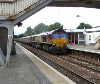 66 147 rumbles north through Cumbernauld with a train of hoppers on 14 Aug 2010.<br><br>[David Panton&nbsp;14/08/2010]