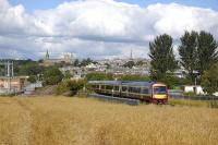 An SPT-liveried 170 approaches Charlestown Junction with Dunfermline's skyline in the background.� A south to west chord has been proposed here, passing through the old gasworks site on the left. This would accommodate direct Stirling - Alloa - Edinburgh (and Rosyth freight) trains without the need for reversal.<br> <br><br>[Bill Roberton&nbsp;16/08/2010]
