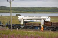 A sleeper laying train on the shore of Hillend reservoir on 16 August 2010; close-up of the transfer unit which lifts sleepers off the wagon and shuttles them to the front of the train<br> <br><br>[Bill Roberton&nbsp;16/08/2010]