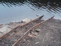 Close up of the narrow gauge rails that were possibly laid as a maintenane track and, long disused, are normally under the water in Grizedale reservoir but have been <I>on show</I> through the summer droughts. There are no quarries nearby and it may be that they were used to transport dam construction materials up the Grizedale valley around 1866. Can anyone confirm this? <br><br>[Mark Bartlett&nbsp;16/08/2010]