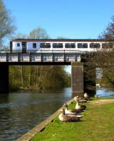 A National Express class 156 passes over the River Bure at Wroxham on 17 April 2010 with a service for Sheringham. <br><br>[Ian Dinmore&nbsp;17/04/2010]