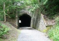 The south portal of Eshiels tunnel, on the eastern edge of Peebles, seen here on 1 August 2010. The 70 yard long, curved, single-track tunnel, brought the Peebles Railway east out of the town and under the A72 road on its way to Galashiels. The tunnel was sealed and the cutting forming the western approach infilled following closure of the line by BR in 1962. It was recently reopened (spring 2010) as part of a walkway / cycleway between Peebles and Innerleithen, with the project jointly funded by Sustrans and Scottish Borders Council.<br><br>[John Furnevel&nbsp;01/08/2010]