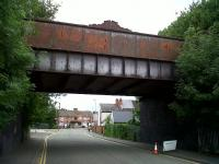 This nicely decorated bridge on the line from Three Spires Junction to the WCML used to carry trains of Rootes car bodies from Linwood, Renfrewshire, to Gosford Green, Coventry. When Linwood closed, rail traffic stopped. Now the Rootes/Chrysler/Talbot/Peugeot plant has been demolished, but the old bridge remains...<br><br>[Ken Strachan&nbsp;13/06/2010]