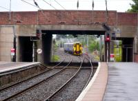 The 07.09 from Stranraer runs into Ayr on 29 July 2010. The passage under the bridge to the left used to lead to the south bay platforms, now a car park covers the area.<br><br>[Colin Miller&nbsp;29/07/2010]
