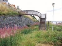 In need of refurbishment, the half footbridge east of the site of Buckpool station (of which nothing remains) on the Moray Coast line, seen here on 22 August 2010. <br> <br><br>[John Gray 22/08/2010]