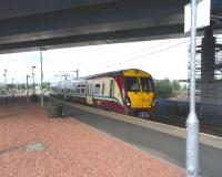 Temporary decks are down on the bridge carrying the M74 extension <br> over Rutherglen station further changing the character of the formerly rather exposed platforms.� It will change even more when traffic starts thundering overhead (whenever that might be).� 334 013 pulls in with a southbound service on 14 August. <br> <br><br>[David Panton&nbsp;14/08/2010]