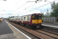 The driver of 314 205 has changed ends at Newton on 14 August and is ready to return to Glasgow, this time via Maxwell Park.� There is no reason why these trains from the Cathcart lines can't continue towards Motherwell, as they have done in the past [see image 30117], but for decades now these services have stuck to their rigid timetable, leaving the lines beyond Newton East Junction to Argyle Line services.�<br><br>[David Panton&nbsp;14/08/2010]