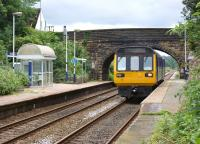 142048 calls at Pleasington station in the leafy suburbs to the <br> west of Blackburn on 29 July 2010 with a Colne to Blackpool South service.<br> <br><br>[John McIntyre&nbsp;29/07/2010]