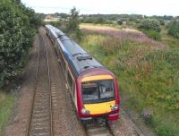 The course of the 'Dubbie Shunt' can just be made out on the far right as 170 476 heads south at speed, about to pass the site of Dysart station in August 2010.  This short branch served the Frances Colliery, which was known locally as 'The Dubbie' after a sea-facing brae - which was ruined by the sinking of the pit!<br><br>[David Panton&nbsp;21/08/2010]